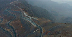 Twisty tirvy roads from above Jabal al Jais Mt Stock Footage