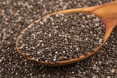 Chia seeds in wooden spoon Stock Photos