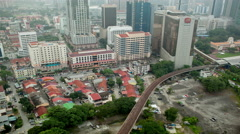 Bird eye time lapse view of railways across road against city landscape. Kuala Stock Footage