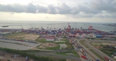 Flying and showing whole commercial port Stock Footage