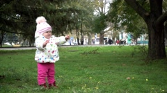 Girl Baby First Steps - City Park Autumn - Mom and Child Stock Footage