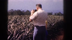 1961: stopping to take some photographs with his son. HAWAII Stock Footage