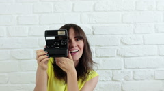 Beautiful woman taking a picture with instant camera HD Stock Footage