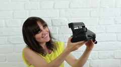 Young happy woman taking selfie with instant camera  HD Stock Footage