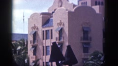 1961: an amazing apartment with many floors with some trees in the premises Stock Footage