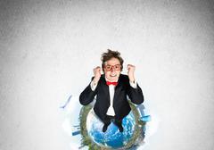 Businessman on Earth globe Stock Photos