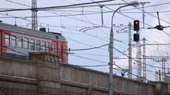 Urban View. Electric Train Crossing the Bridge on Low Speed. Concrete Building. Stock Footage