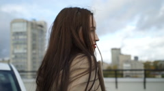 Beautiful girl standing on the street Stock Footage