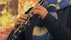 Hands of the musician clarinetist closeup, Zoom out in blur Stock Footage