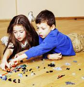 Funny cute children playing at home, boys and girl smiling, firs Stock Photos