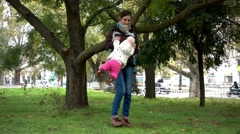 Mom Plays with Child in City Park Autumn Stock Footage