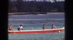 1961: members holiday rowing boat free time at beach in the evening happily Stock Footage