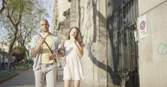 4K Happy attractive couple on vacation in Italy enjoying ice creams Stock Footage