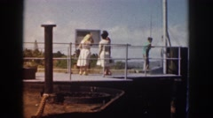 1961: naval officer in white uniform speaks to boy at pier railing  Stock Footage