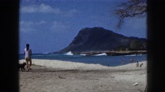 1961: female walking sea shore with pet dog wind blowing beautiful sight beach Stock Footage