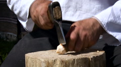 Village. Man Showing How to Use an ax to Make a Craft. Short Peg. Man Cutting Stock Footage