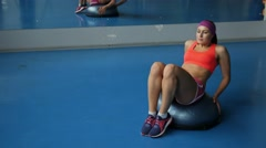 Young woman doing abdominal exercises at sport gym Stock Footage
