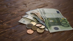 Euro Bills and Coins turn around. Stock Footage