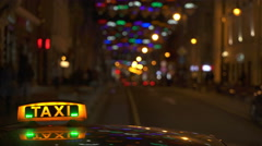 Illuminated Sighn of Taxi Cab in Night City Stock Footage