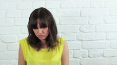 Portrait of young brunette woman with boring look HD Stock Footage