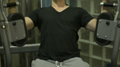 Seated butterfly pec deck exercise Stock Footage