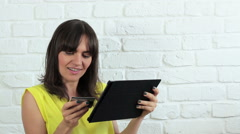 Woman doing on line shopping from tablet computer HD Stock Footage