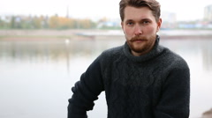 Handsome bearded man on the background of the river Stock Footage