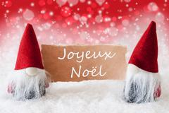 Red Christmassy Gnomes With Card, Joyeux Noel Means Merry Christmas Stock Photos