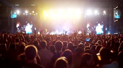 Raised hands at a rock concert simultaneously clapping, crowd of spectators on Stock Footage