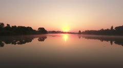 Aerial view of Sunrise on a misty lake. Morning landscape with fog on a river Stock Footage