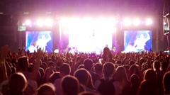 Raised a lot of brightly lit hands at a concert, a large number of people, the Stock Footage