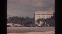 1961: battleship on ocean to buildings by fields HAWAII Stock Footage