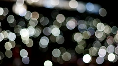 Colored lights blurred, background, abstract, funny colored circles on a dark Stock Footage