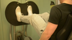 Man using leg press Stock Footage