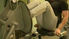 Man using leg press machine Stock Footage