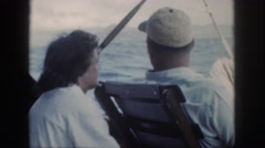 1961: man lady on a cruise by sea side on vacation enjoying the ride having fun Stock Footage