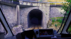 Train exits a tunnel Stock Footage