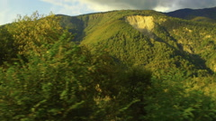 View of a mountain landscape from a runaway train Stock Footage