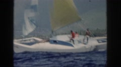 1961: people trying to keep their sailboat afloat. HAWAII Stock Footage