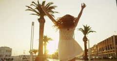 4K Beautiful woman enjoying life, spinning around in the city in summertime Stock Footage