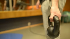 Hand holding kettlebell Stock Footage