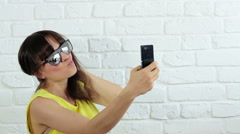 Young happy woman taking selfie on mobile phone HD Stock Footage