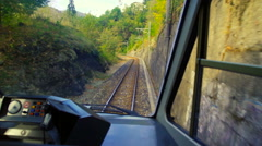 View of a mountain landscape from the cockpit of a train Stock Footage