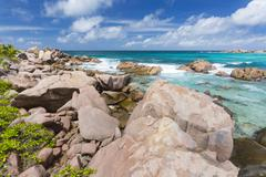 Granite rocks and turquoise water at Anse Cocos in La Digue, Seychelles Stock Photos