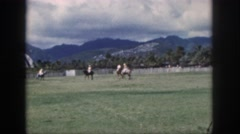 1961: riders compete in polo on horses while spectators watch them. HAWAII Stock Footage