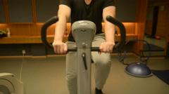 Man riding stationary bike Stock Footage