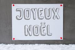Label On Cement Wall, Snow, Joyeux Noel Means Merry Christmas Stock Photos