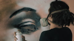 4K Close up of young urban artist creating a mural with spray paint Stock Footage