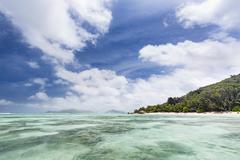 Anse Source D'Argent in La Digue, Seychelles filled with tourists seen from t Stock Photos