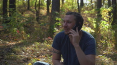 Boy use telephone outdoors landscape indian summer Stock Footage